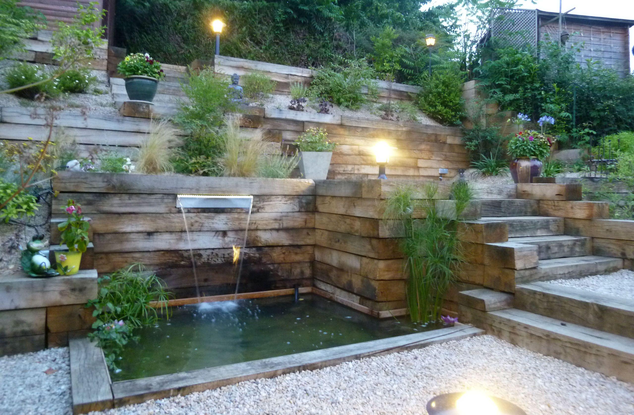 Réalisation d'un jardin en pente piscine