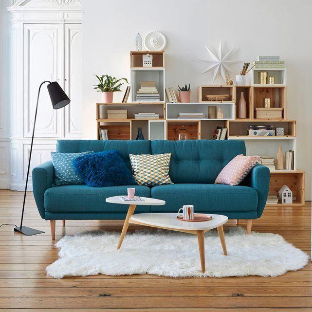 Jolie déco de salon avec canapé bleu canard type retro
