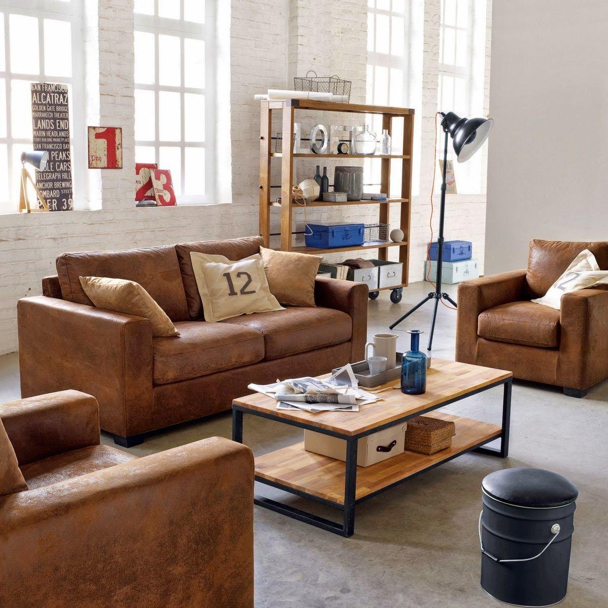 Salon à la décoration style industriel canapé façon cuir