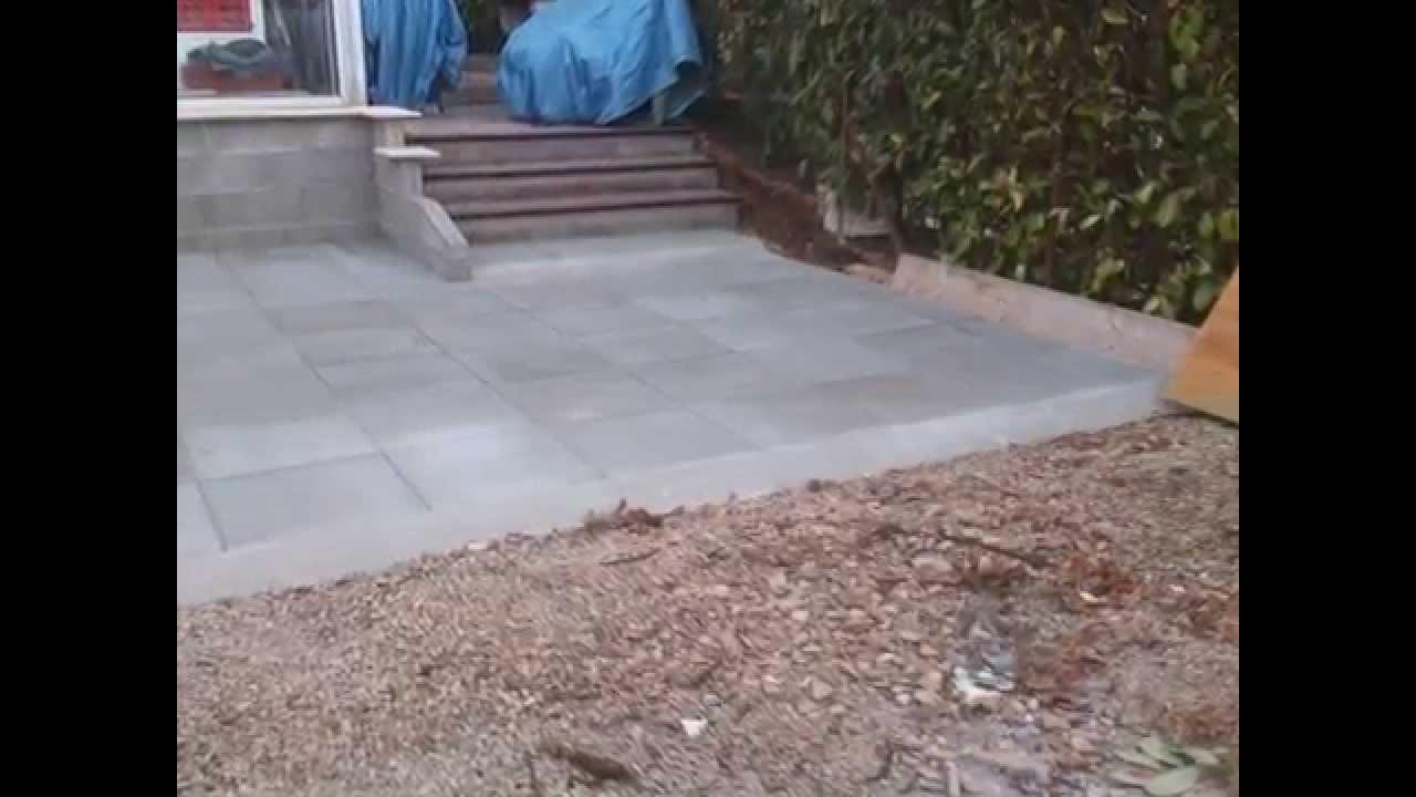 Terrasse en dalle béton sur lit de sable