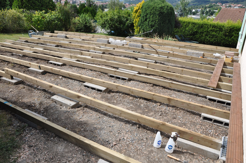 Montage d une terrasse en bois sur plot beton veranda