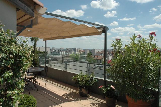 Protection solaire vent et vis à vis au 8° étage plein