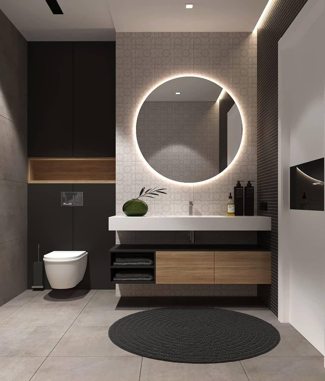 Salle de bain moderne dans des tons gris et noir avec