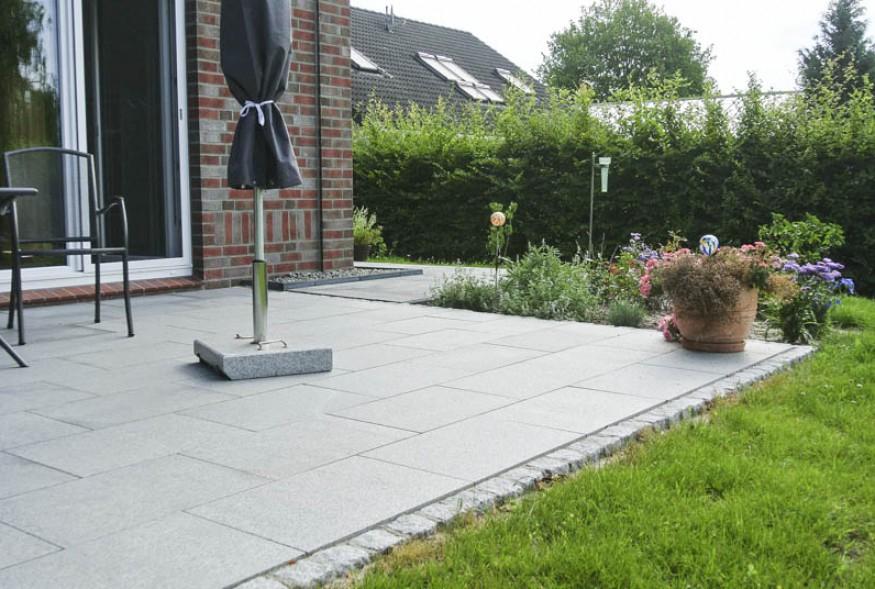 Pflasterarbeiten Granitstufen und Terrasse Bollmeyer Bau