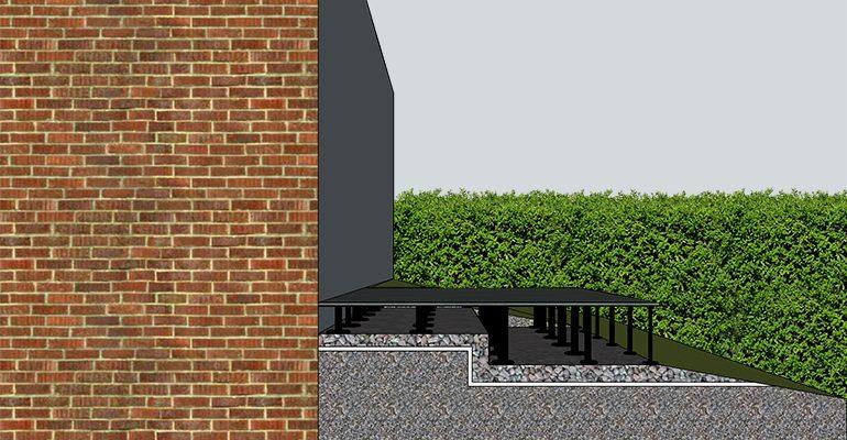 Construire sa terrasse en dalles sur un jardin en pente