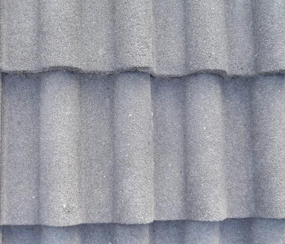 Entretien des tuiles en béton d'une toiture à Pontault