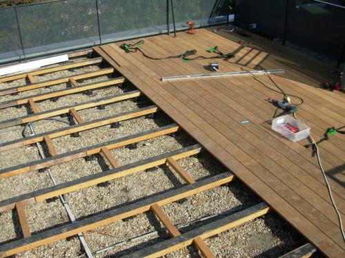 Terrasse en bois sut toit terrasse à refaire